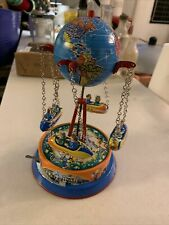 GLOBE CAROUSEL TIN TOY ROCKET RIDE  LEVER ACTION GERMAN MADE  BY JOSEF WAGNER