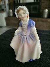 """Royal Doulton Figurine """"Dinky Do"""". 4 1/2 inches tall. Beautiful Condition"""