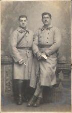 Photo carte deux soldats du 231 régiment d'infanterie veste gants casque bottes