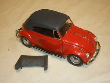 A Franklin mint scale model of a 1967 Volkswagen Beetle convertible.