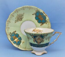 UCAGCO JAPAN CUP AND SAUCER SET IRIDESCENT GREEN GOLD