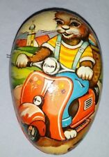 Vtg Paper Mache Western Germany Easter Egg Candy Container w/Bunny on Scooter.