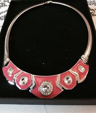 Pretty silver toned choker with pink enamel and silver coloured rhinestones