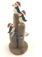 Kinetic Puffins with Christmas Hats Sitting on Driftwood Base Catching Fish Gift