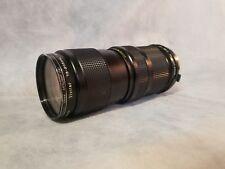 Vivitar 75-205 mm 1:38 close focusing auto zoom No. 22613141/ filter skylight 1a