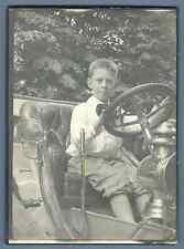 France, Garçon au volant d'une voiture d'époque  Vintage silver print.