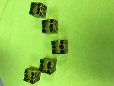 Yellow casino dice with black dots