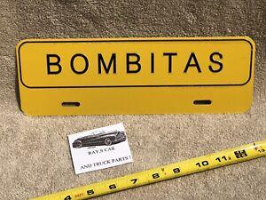 NEW BOMBITAS UNIVERSAL LICENSE PLATE TOPPER .