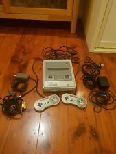 Super Nintendo with 7 games and 2 controllers