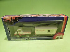 SIKU 2519 UNIMOG WITH BUILDER'S HUT - HEITKAMP - 1:55 - GOOD CONDITION IN BOX