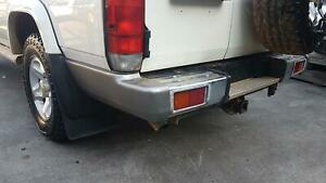 TOYOTA LANDCRUISER LEFT TAILLIGHT 75/76/78 SERIES, WAGON/TROOP CARRIER, IN BUMPE