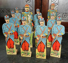fine set 12 cardboard cut out toy soldier on wood stands