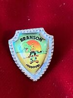 Branson Missouri Shield Arrowhead Shape Hillbilly Holding Gun Tie Lapel Pin Vtg