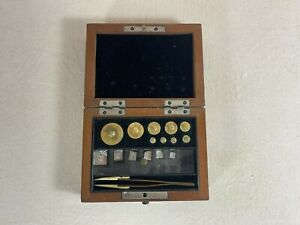 Antique wood boxed gold / silver scale weights set