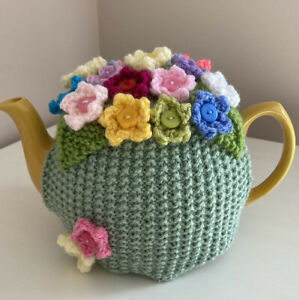 Hand Knitted Lincoln Green Tea Cosy With Flowers. Fits Medium Size Teapot