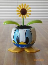 Solar Dancing Flower with Donald Duck name base..dances in sunlight..brand new