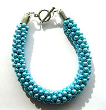 1 Bracelet with Aqua Sea Pearls and Silver Overlay