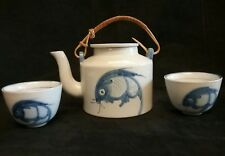 Beautiful Chinese Tea Pot with Cup and Saucer: Fish  decorated.
