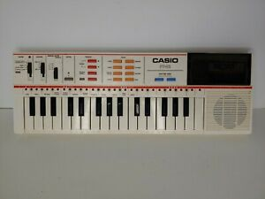 Vintage Casio PT-82 Keyboard w/ Original BoxWorld Songs Rom Card Tested Works!