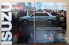 1986 two page  magazine ad for Isuzu - I-Mark Sedan on crowded Japanese street