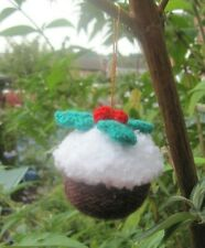 A HAND KNITTED XMAS PUDDING DECORATION. HANG ANYWHERE YOU LIKE.