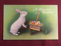 A Joyous Easter fantasy bunny rabbit art wagon eggs Postcard 1910's