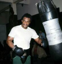 Old Boxing Photo George Foreman Hits The Punching Bag As He Trains 1