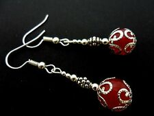 A PAIR OF DANGLY RED JADE BEAD  SILVER PLATED DROP EARRINGS.