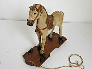 Antique Hide Covered Platform Horse Pull Toy