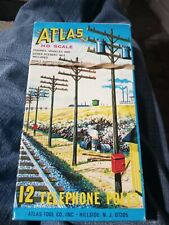 Atlas package of 12 telephone poles  #775 HO scale