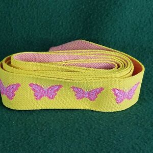1 5/8 inch Elastic. Yellow with pink butterflies. 7+ feet long.