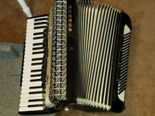 HOHNER atlantic IV Deluxe piano accordion musset with a wrist switch and case.