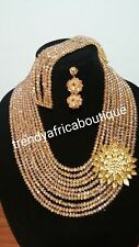 Gold Crystal beaded necklace set with a side broach. Multi layer beaded-necklace