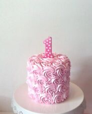 GIRLS FAKE SMASH CAKE PHOTO PROP, PINK ROSETTES, NUMBER ONE PINK CANDLE