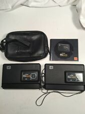 2 * Kodak Disc 6000 cameras with case and instructions.