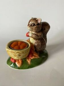 Squirrel with a nut ceramic tealight holder fall decor