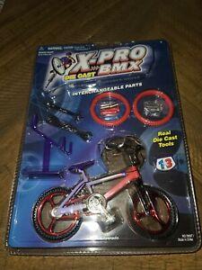 NEW NIP VINTAGE X-PRO DIE CAST BMX 79037 SILVERADO BICYCLE