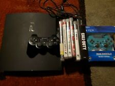 Playstation 3 w/2 controllers, 8 games power cord