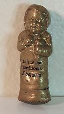 Antique brass figural (baby) vesta match safe Charles Mann Grand Hotel Aberdeen