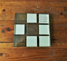 SOLID GLASS TABLE MAT ? HOLDS 8 SMALL PHOTOS,5cm x 5cm , QUITE HEAVY,