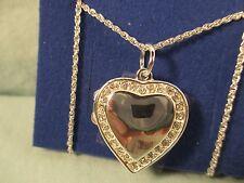 2004 Avon silver tone locket + 12 Rhinestones surrounding the heart