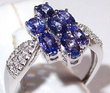 7-stone Tanzanite (1.80ct) ring with Zircon shoulders in 9k White Gold. Size N.