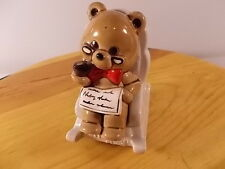 Norcrest Retirement fund bank Bear in rocking chair