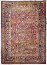 Distressed Antique Persian Mashad rug. 11'x 17'