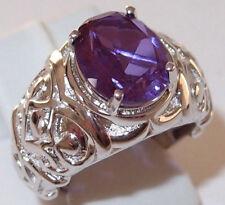 3.5ct Alexite ring (colour change lavender) in platinum bond. Size L.