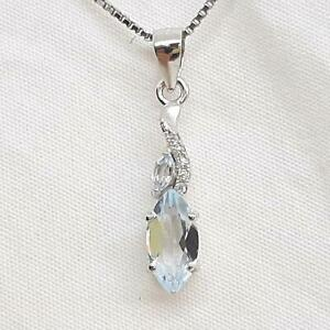 1.33ctw Swiss Topaz & Diamond Cut White Sapphire 925 Sterling Silver Pendant