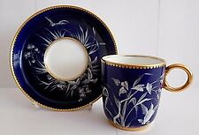 MINTON PATE SUR PATE ENAMELLED COFFEE CUP AND SAUCER WITH DRAGONFLY AND BIRD