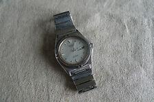 Nice vintage Seiko SQ100 men's wrist watch in good conditions