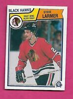 1983-84 OPC # 105 HAWKS STEVE LARMER  ROOKIE ERROR NRMT+ CARD (INV# C1836)