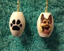 One German Shepherd Dog fan pull with a paw print on the back 1""